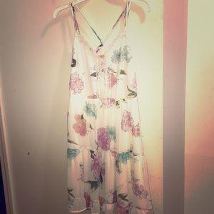 A white floral pattern lose dress